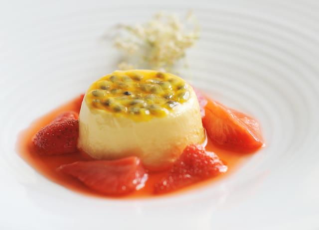 Passion fruit crème with elderflower strawberries
