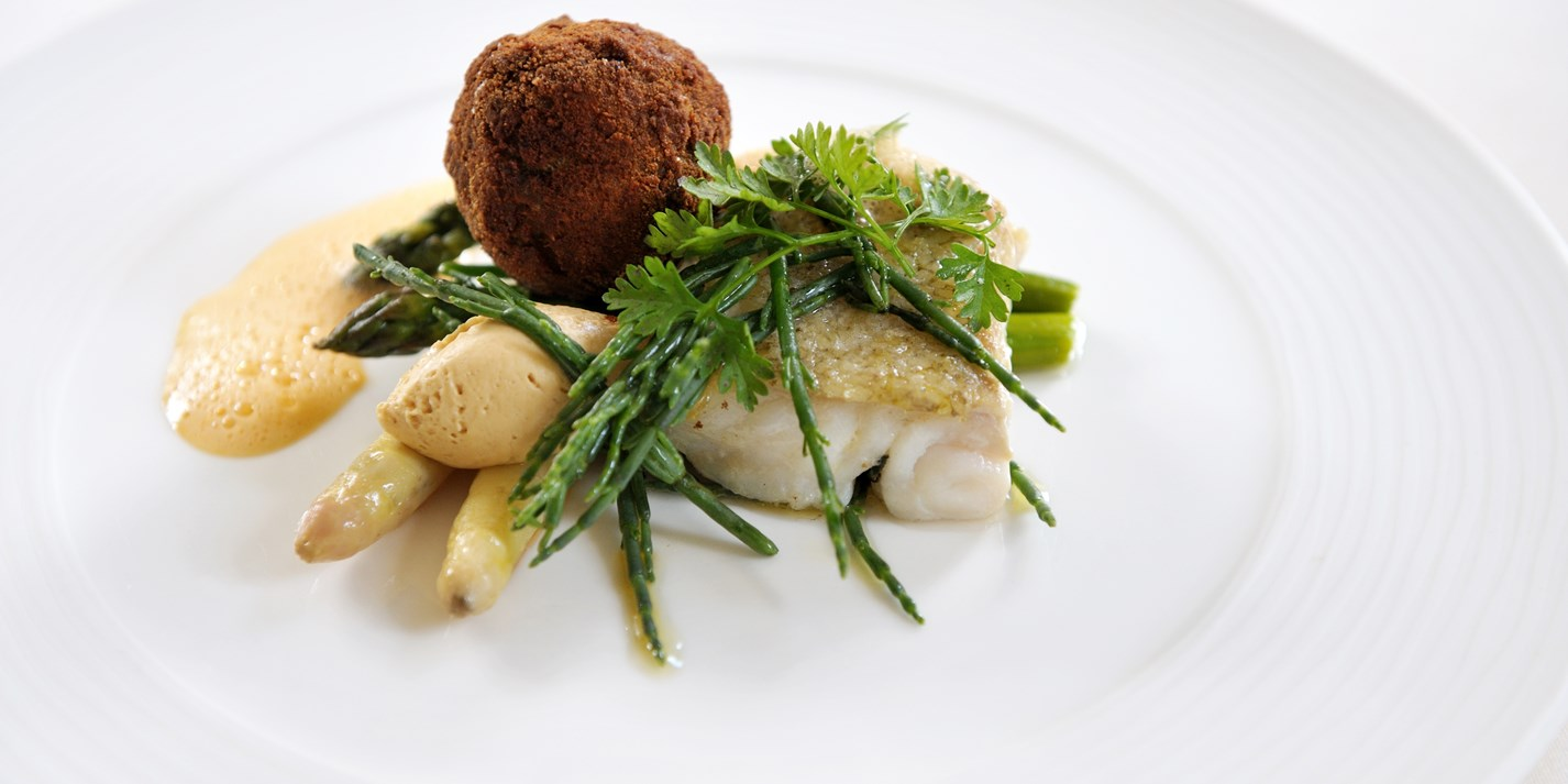 Seared cod with asparagus, crab beignets and samphire