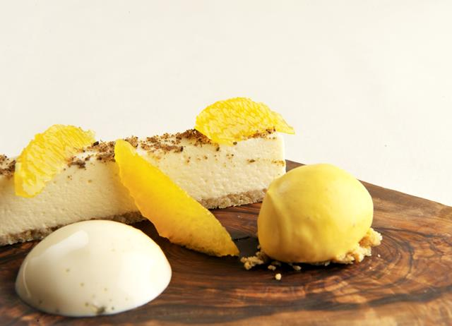 White chocolate mousse with cardamom espuma and clementine sorbet