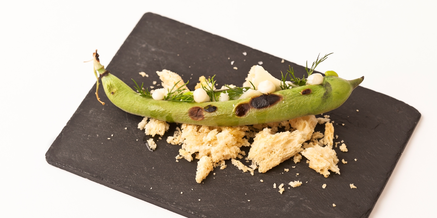 Charred broad beans with St. Jorge cheese and brioche crumbs