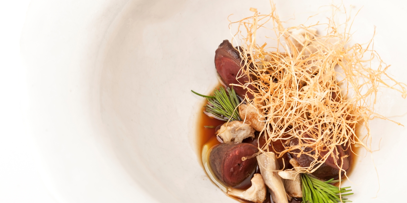 Duck hearts with mushroom floss and spiced broth
