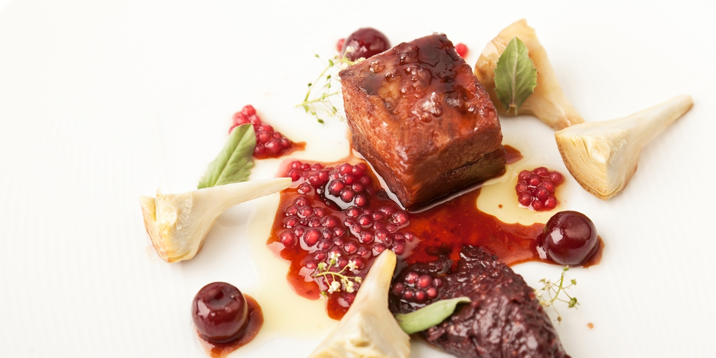 Pork secretos with artichokes and red wine tapioca