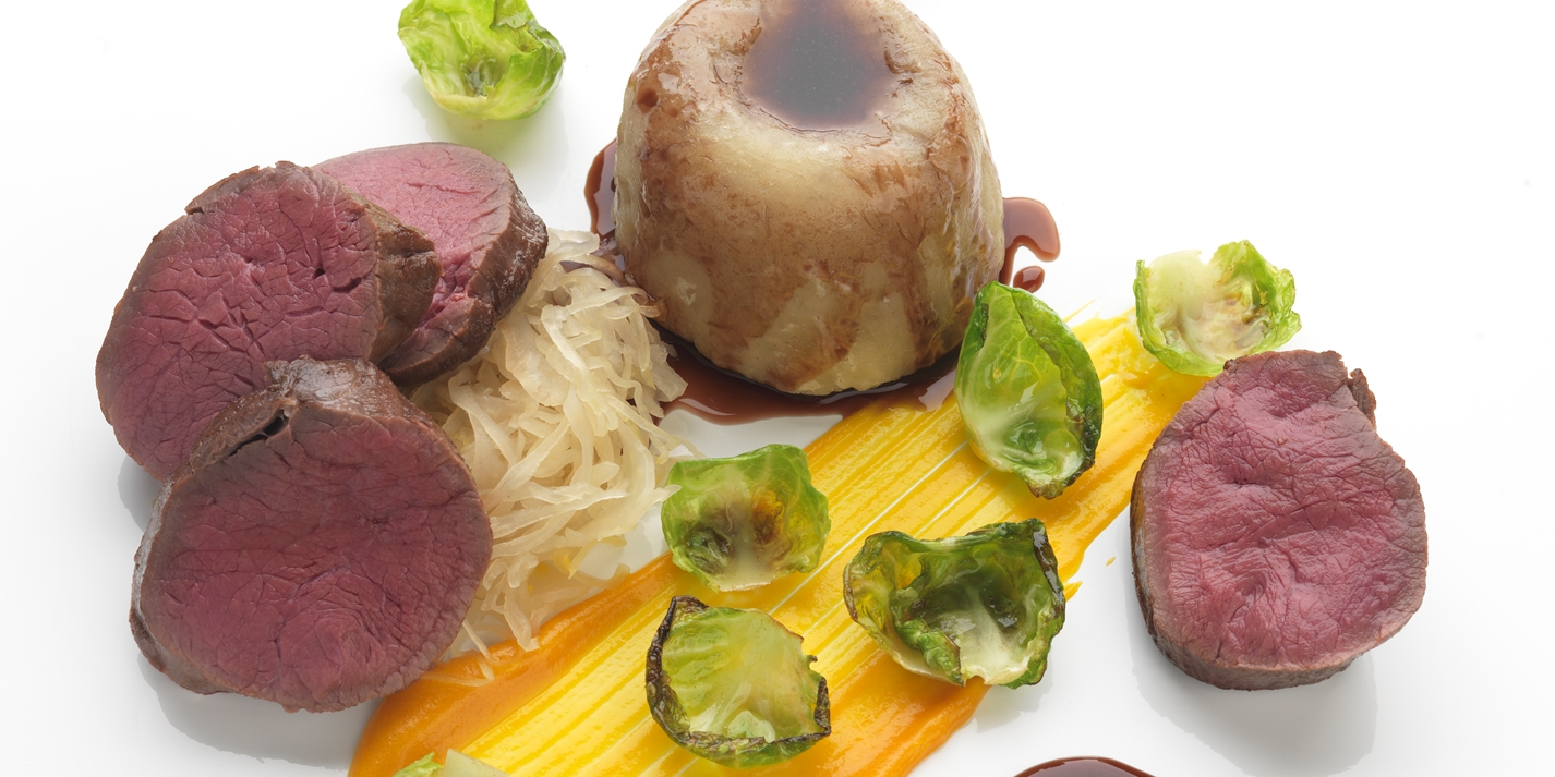 Slow-cooked venison suet pudding with choucroute and carrot purée