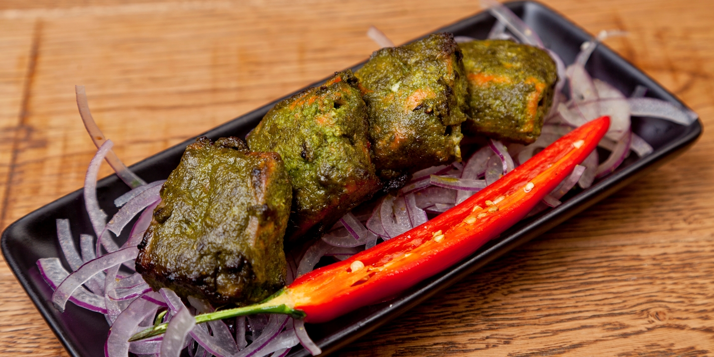 Tandoor-grilled Alaska salmon with lime-leaf and spinach marinade