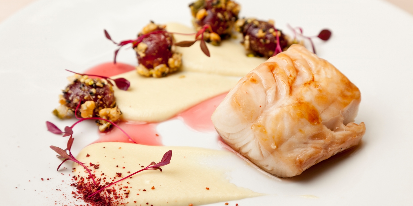 Glazed Alaska black cod with a verjuice sauce and crunchy grapes