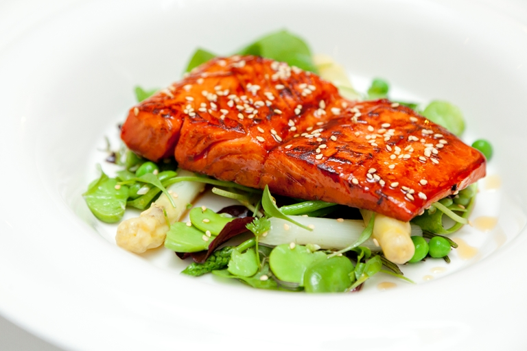 Seared Alaska salmon with maple syrup, lime and soy glaze spring vegetable salad with toasted sesame