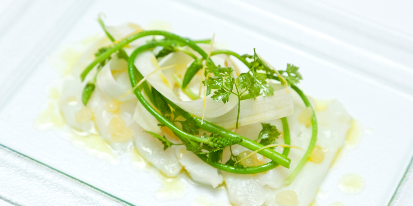 Alaska halibut marinated in lemon vinegar with asparagus and chervil salad