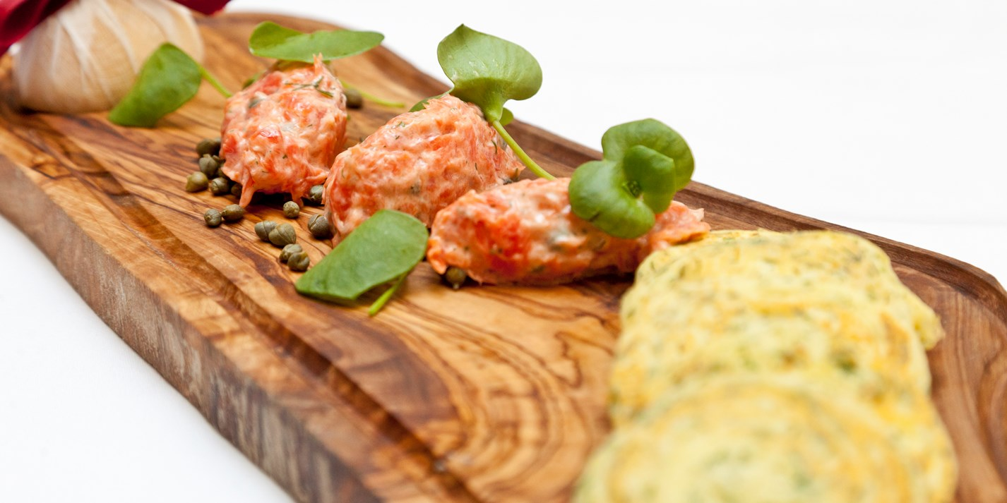 ... salmon rillettes with dill-scented potato pancakes, lemon and capers