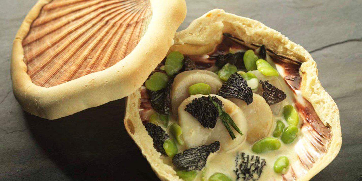 Orkney scallops baked in the shell with morels and broad beans
