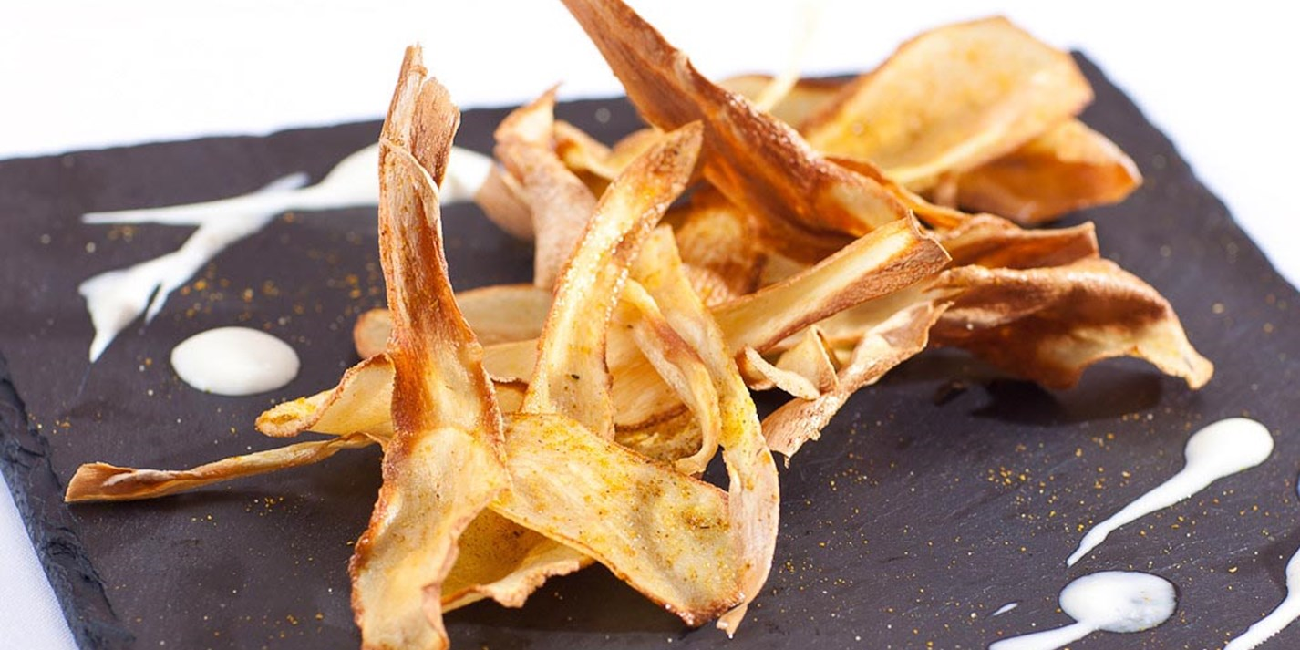 Curry salted parsnip crisps