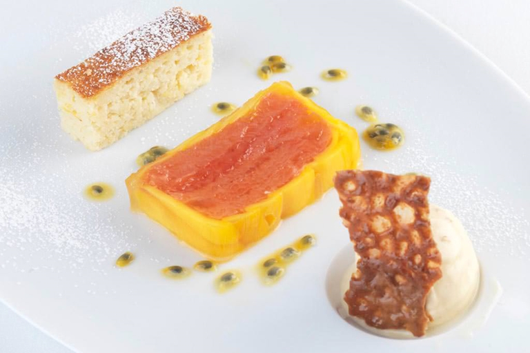 Red grapefruit and mango press, ginger ice cream, ricotta cake and almond brittle