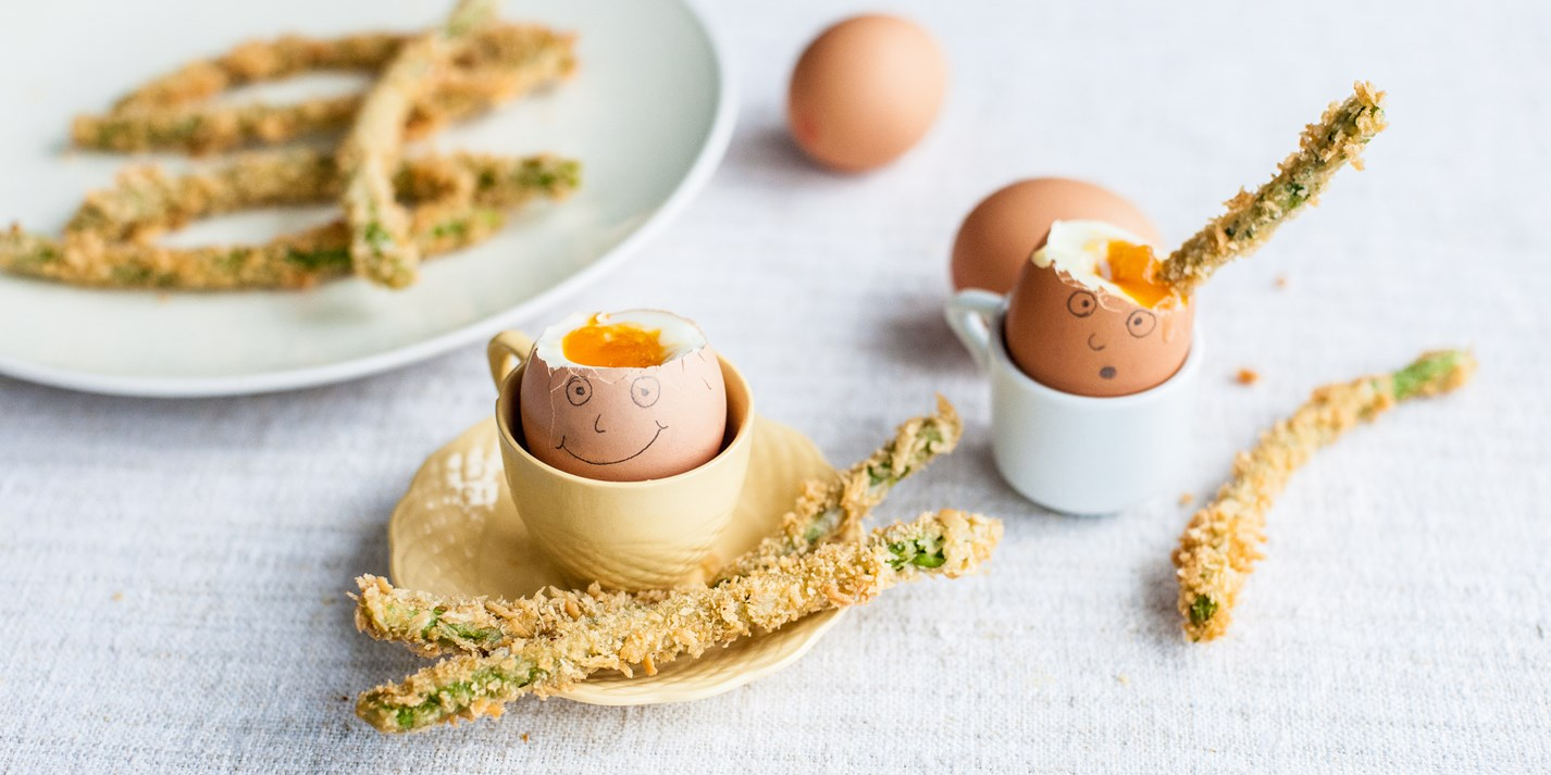 Happy face egg with crispy asparagus soldiers