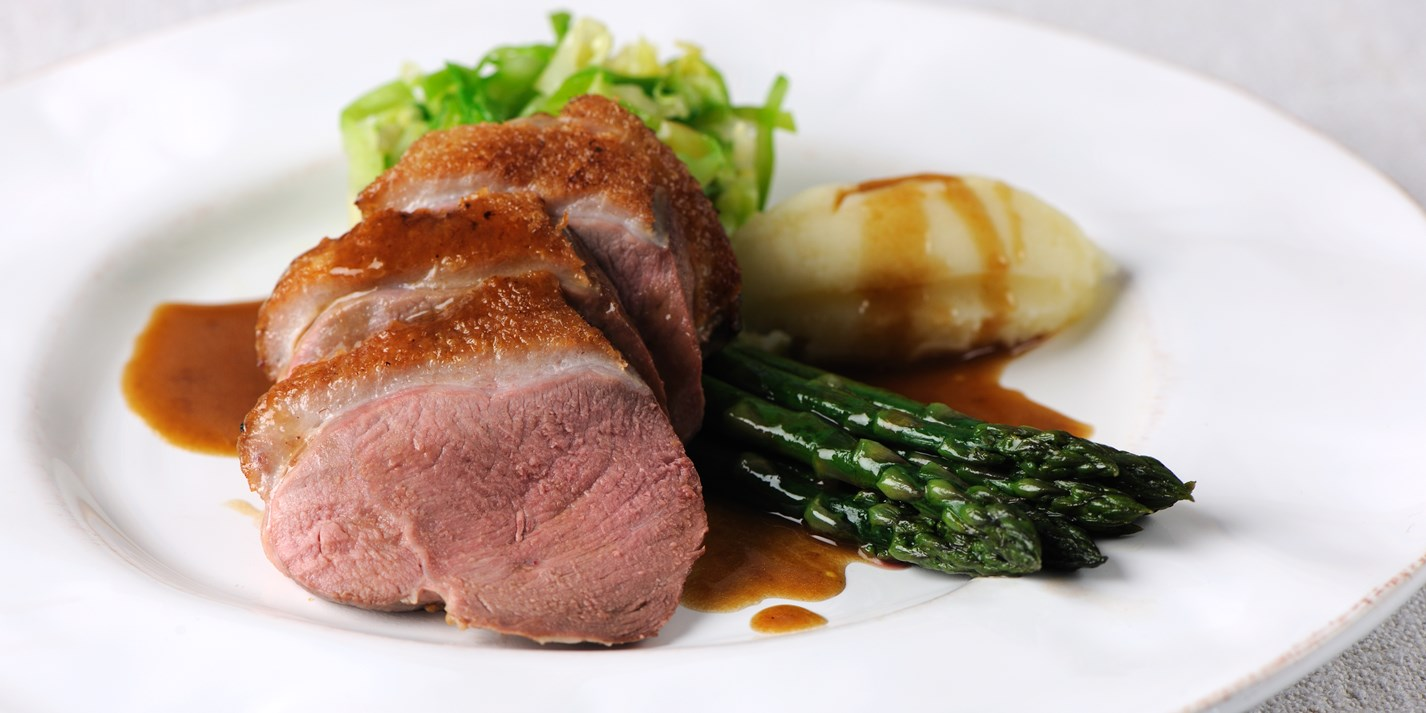 Roast duck breast with asparagus, caramelised shallot and hispi cabbage