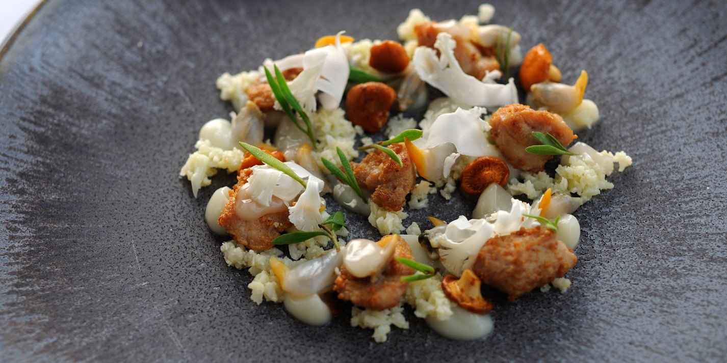 Roasted veal sweetbreads, cockles, cauliflower cous-cous and girolles