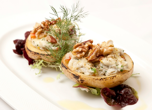 Baked potatoes with crab and walnuts