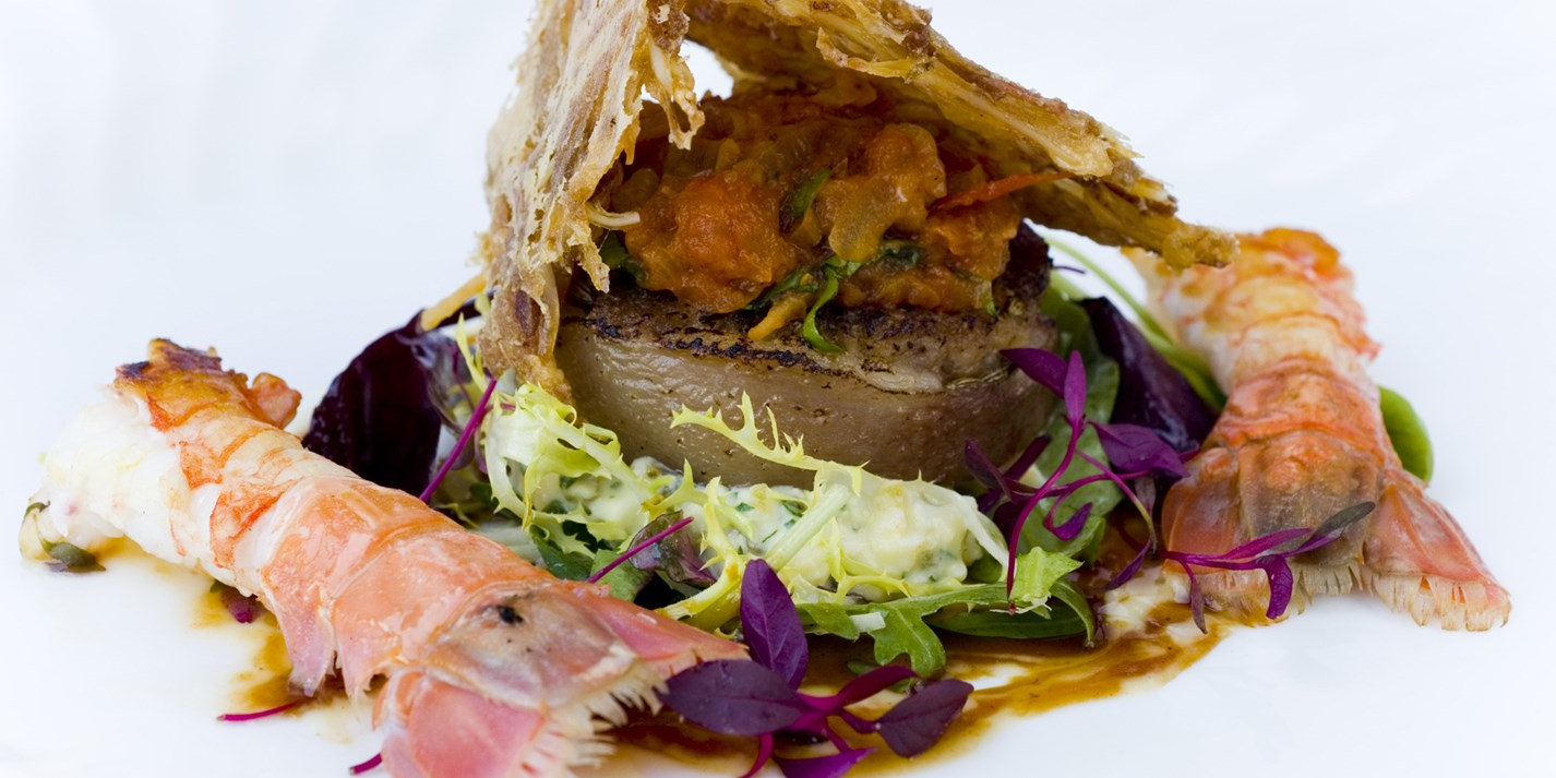 Rolled pig's head with langoustine and a crispy ear salad