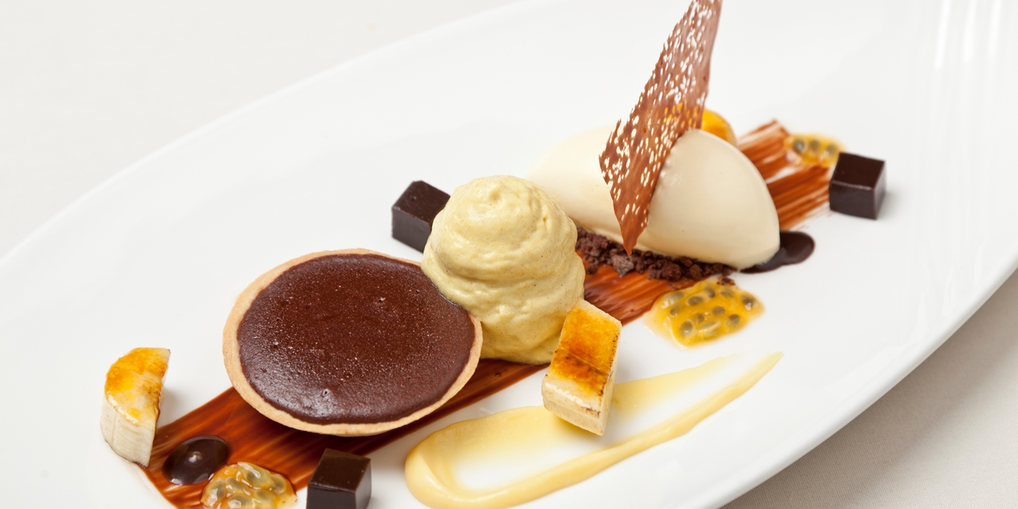 Hot chocolate tart with banana and passion fruit ice cream