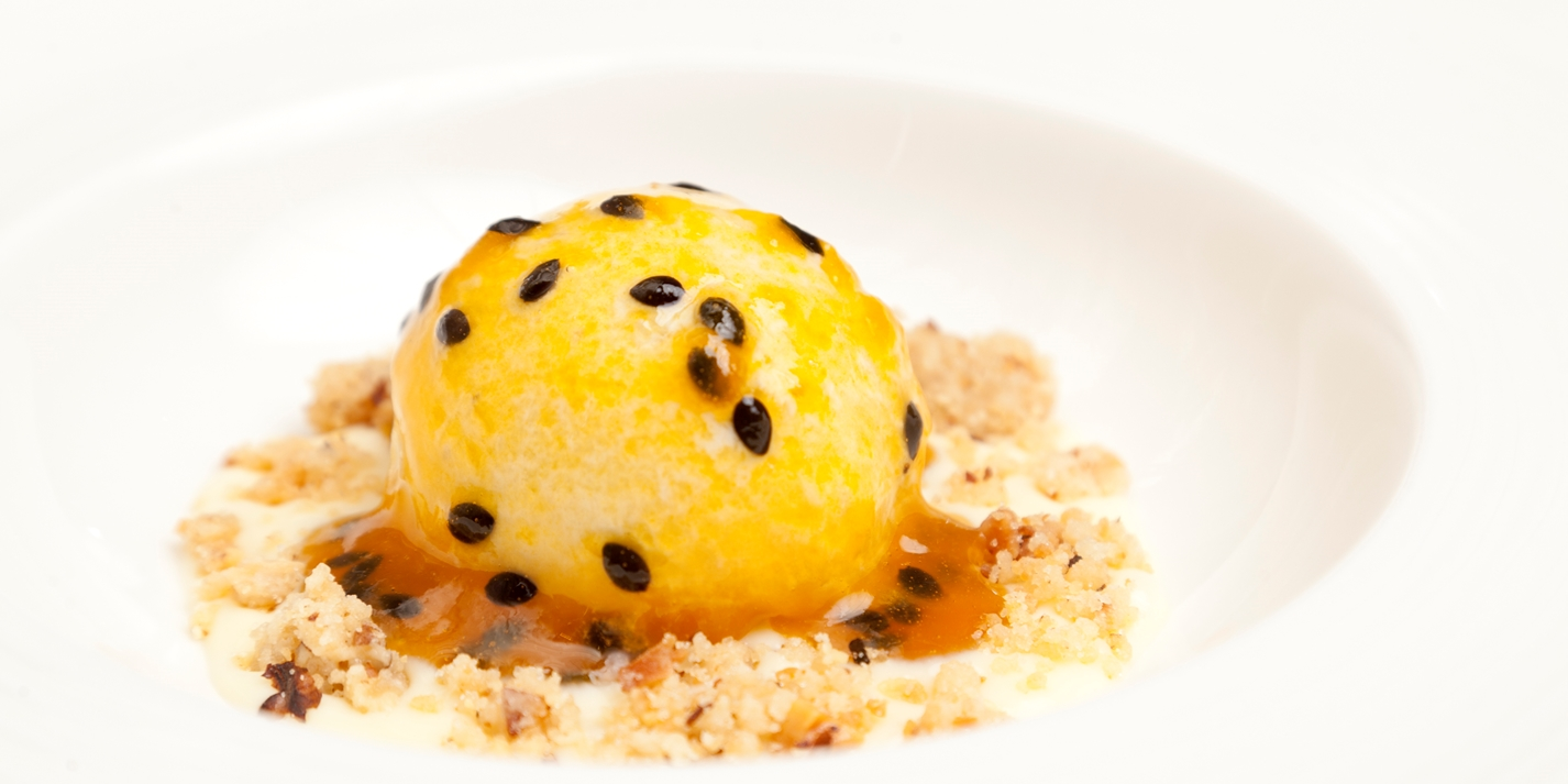 Banana and rum ice cream with passion fruit, walnuts, white chocolate sauce