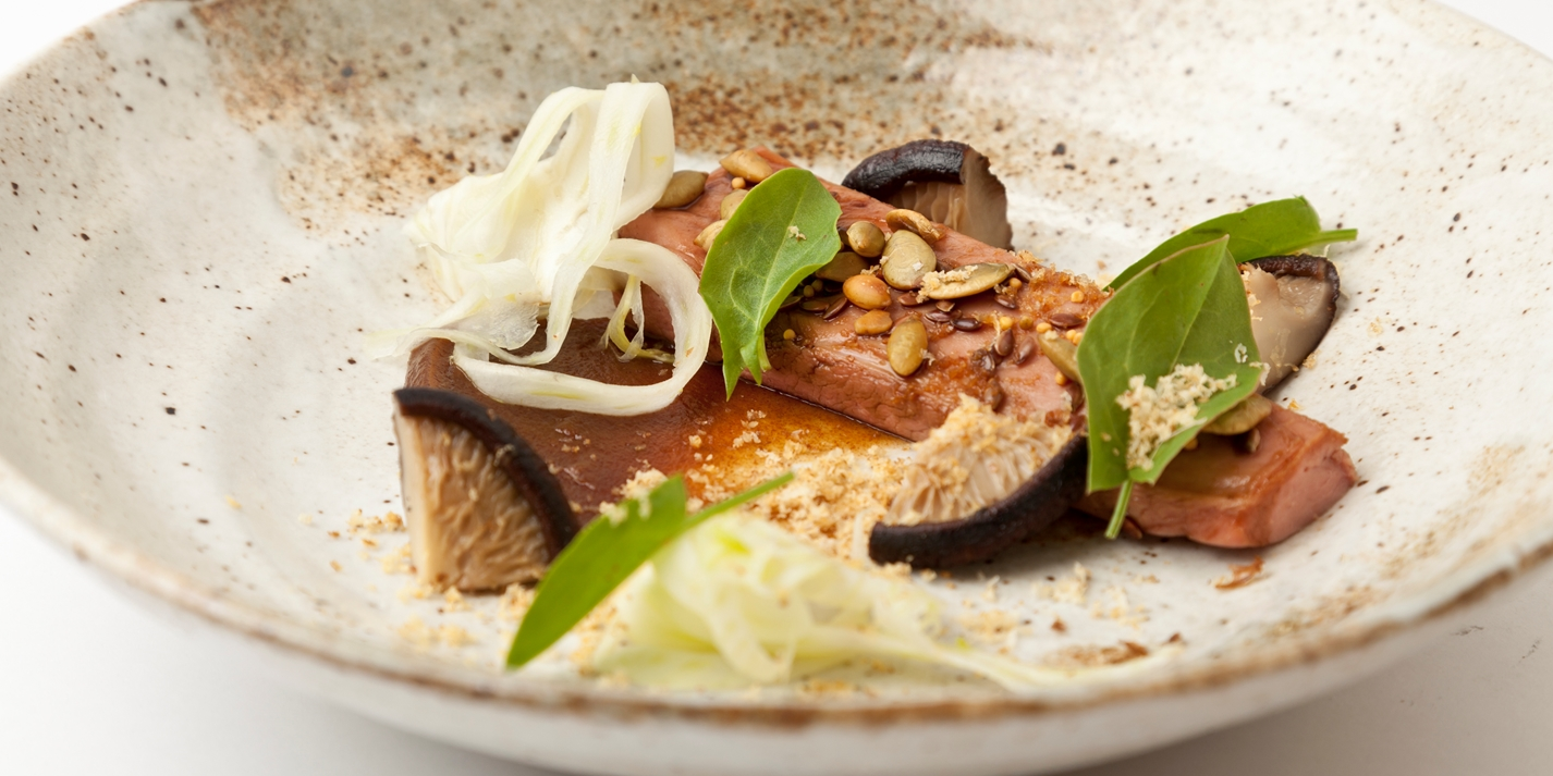 Duck breast glazed in soy with date purée, pickled shiitake, fried walnut, pumpkin seeds