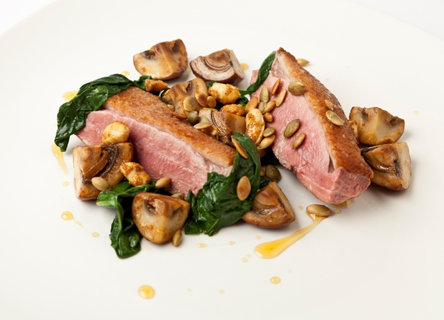 Seared duck breast with sautéed and pickled mushrooms, pumpkin seeds and toasted peanuts