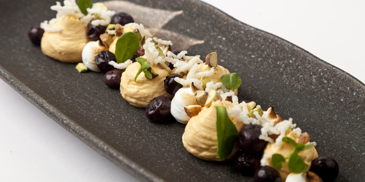 Whipped sea buckthorn with burnt meringue, crispy rice, blueberries and tonka bean gastrique