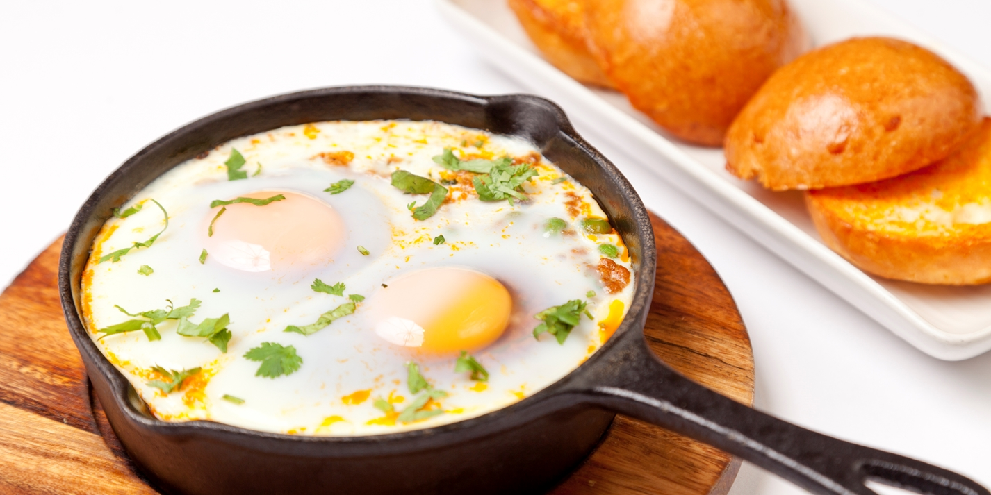 Baked eggs, minced lamb and peas