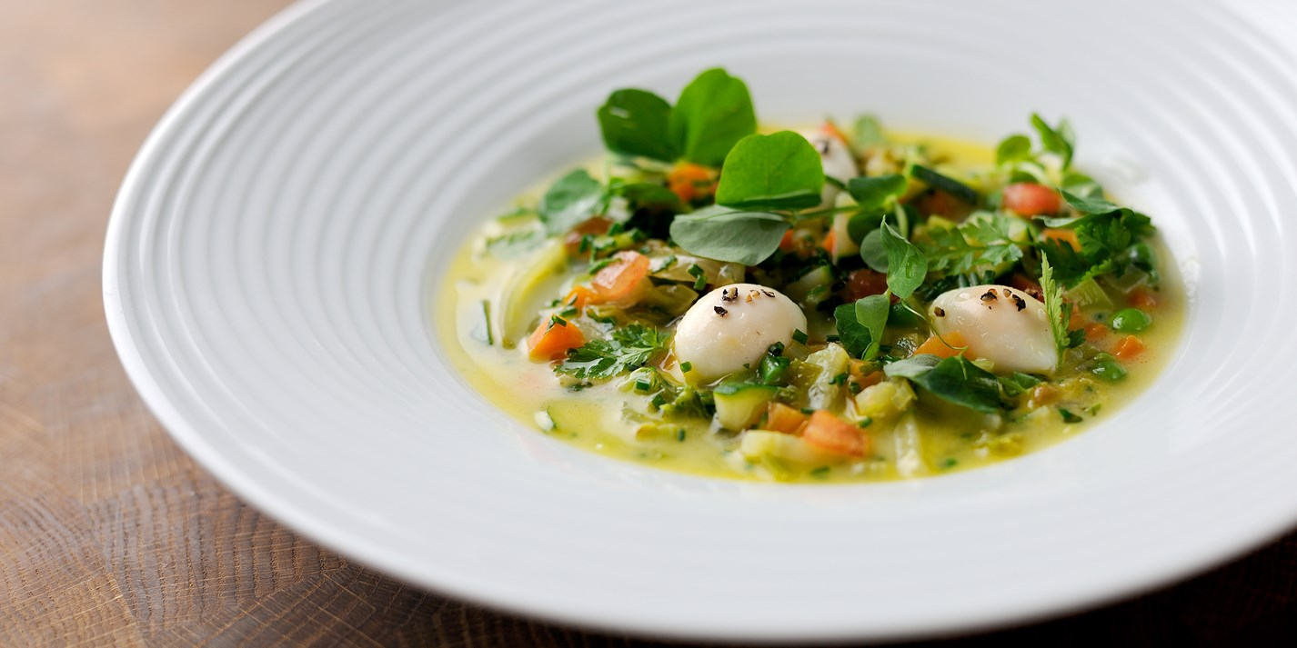 Potage of vegetables with poached duck egg and fresh herbs