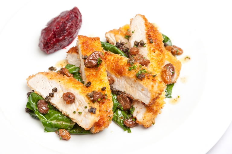 Turkey escalope with beetroot and caper chutney, golden raisins and pan juices