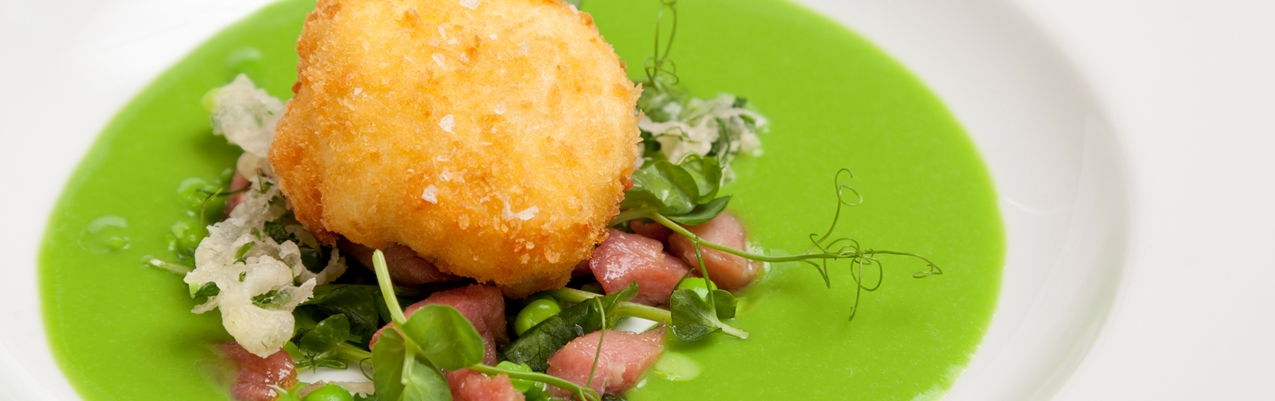 Pea and honey-roasted gammon salad with pea soup and crispy egg