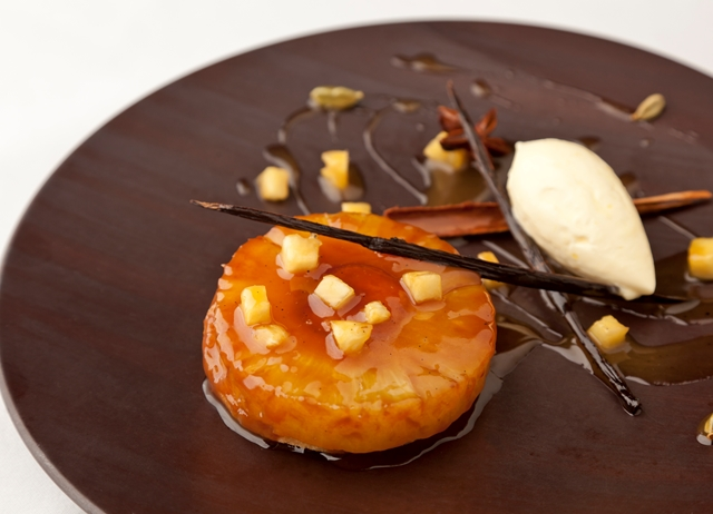 Pineapple upside-down cake, spiced rum caramel, and Devonshire clotted cream