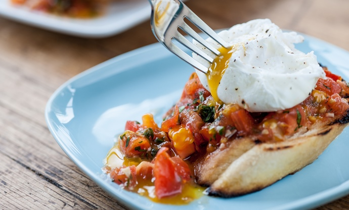 Plum tomato bruschetta with poached eggs