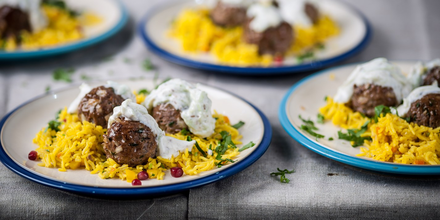Spicy lamb balls with jewelled rice and cumin yoghurt