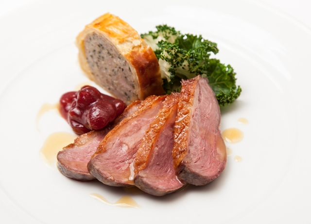 Goose breast with goose leg sausage roll, kale and cranberry relish