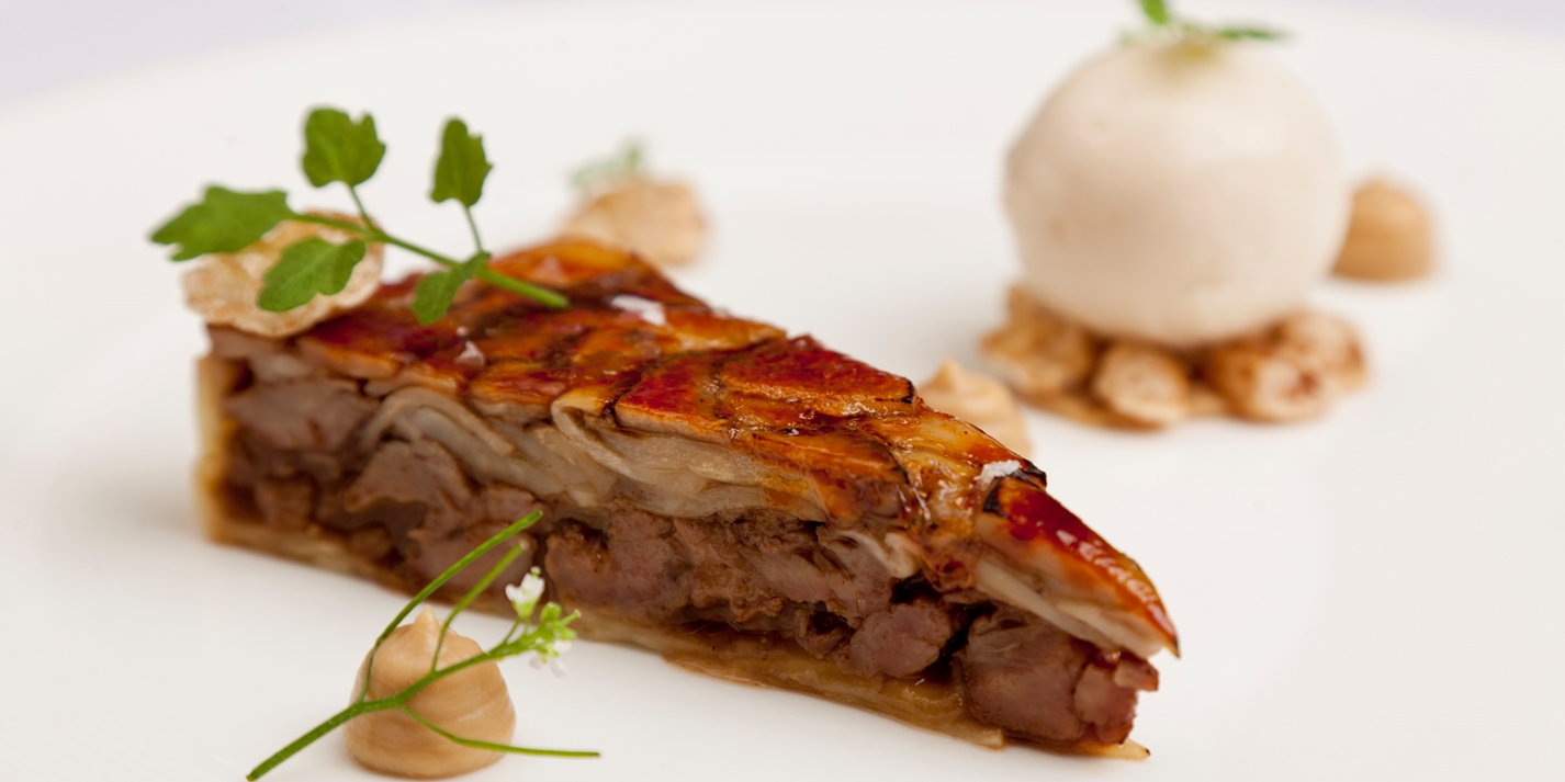 Glazed 'tart' of pig cheeks and penny bun, roasted celeriac, pear sorbet and wild cress