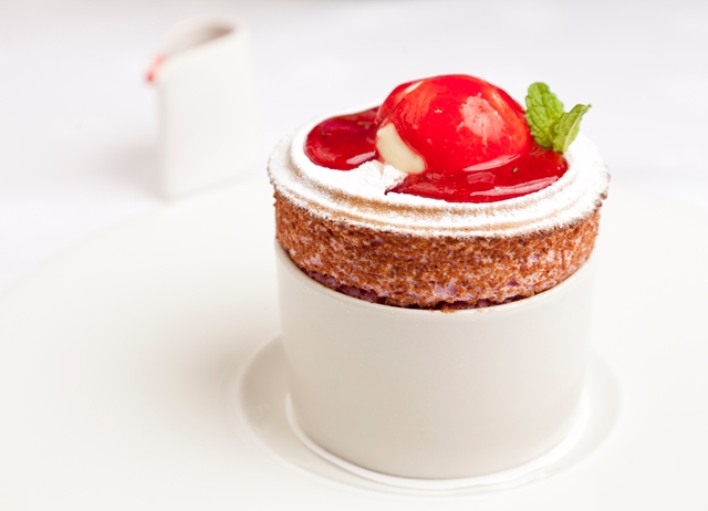 Raspberry soufflé with buttermilk ice cream and raspberry and mint coulis