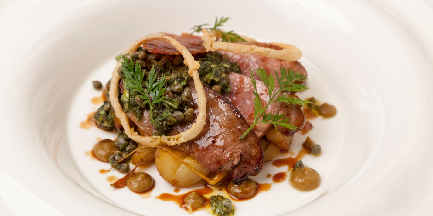 Calf's liver with sage salsa verde, caper, raisins, potatoes and crispy ham