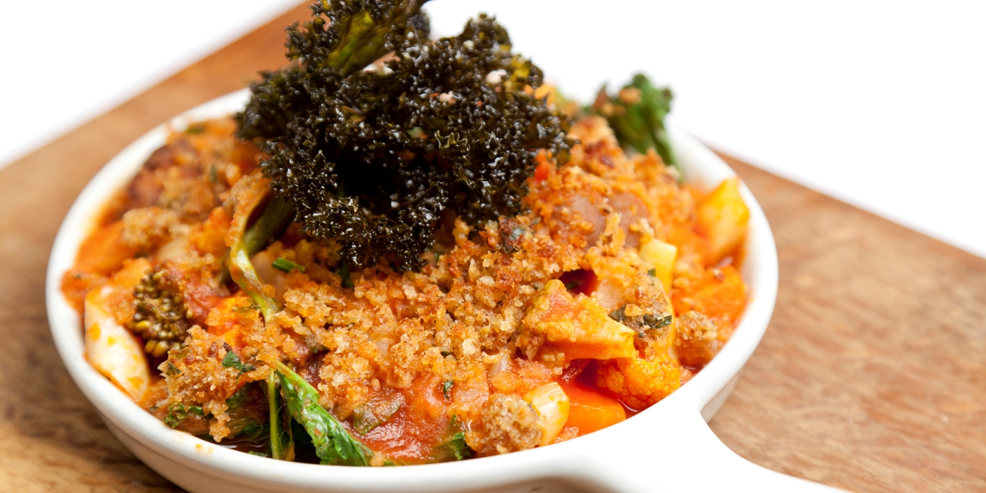 Vegetable and chestnut stew with sage crust and crispy kale