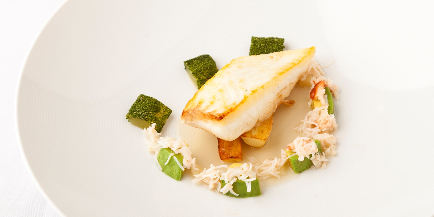Pan-fried halibut, compressed cucumber, crab and lemongrass consommé
