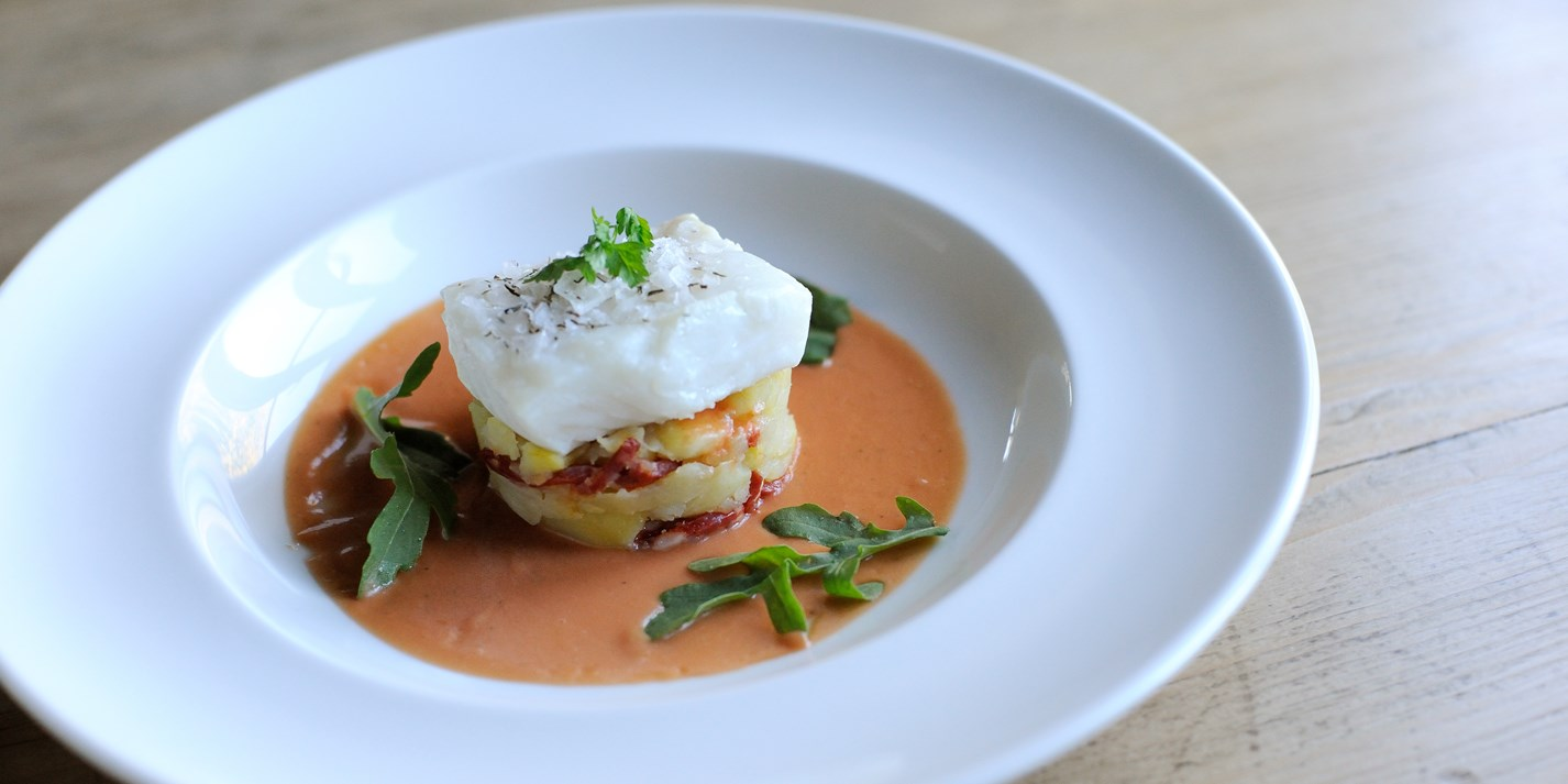Salted cod with crushed potatoes, chorizo, tomato and thyme vinaigrette