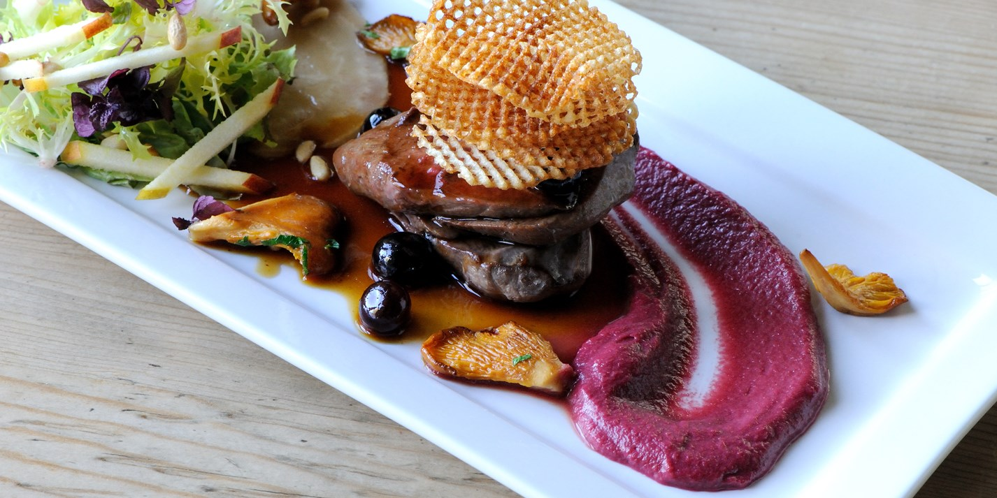 Wood pigeon with blueberry jus, beetroot purée and potato crisps