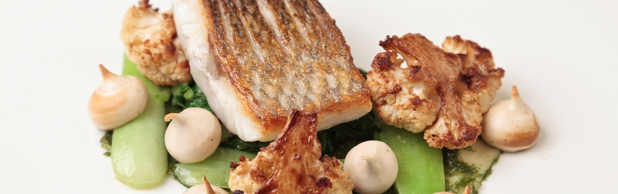 Sea bass with soy sauce meringue, pak choi and cauliflower