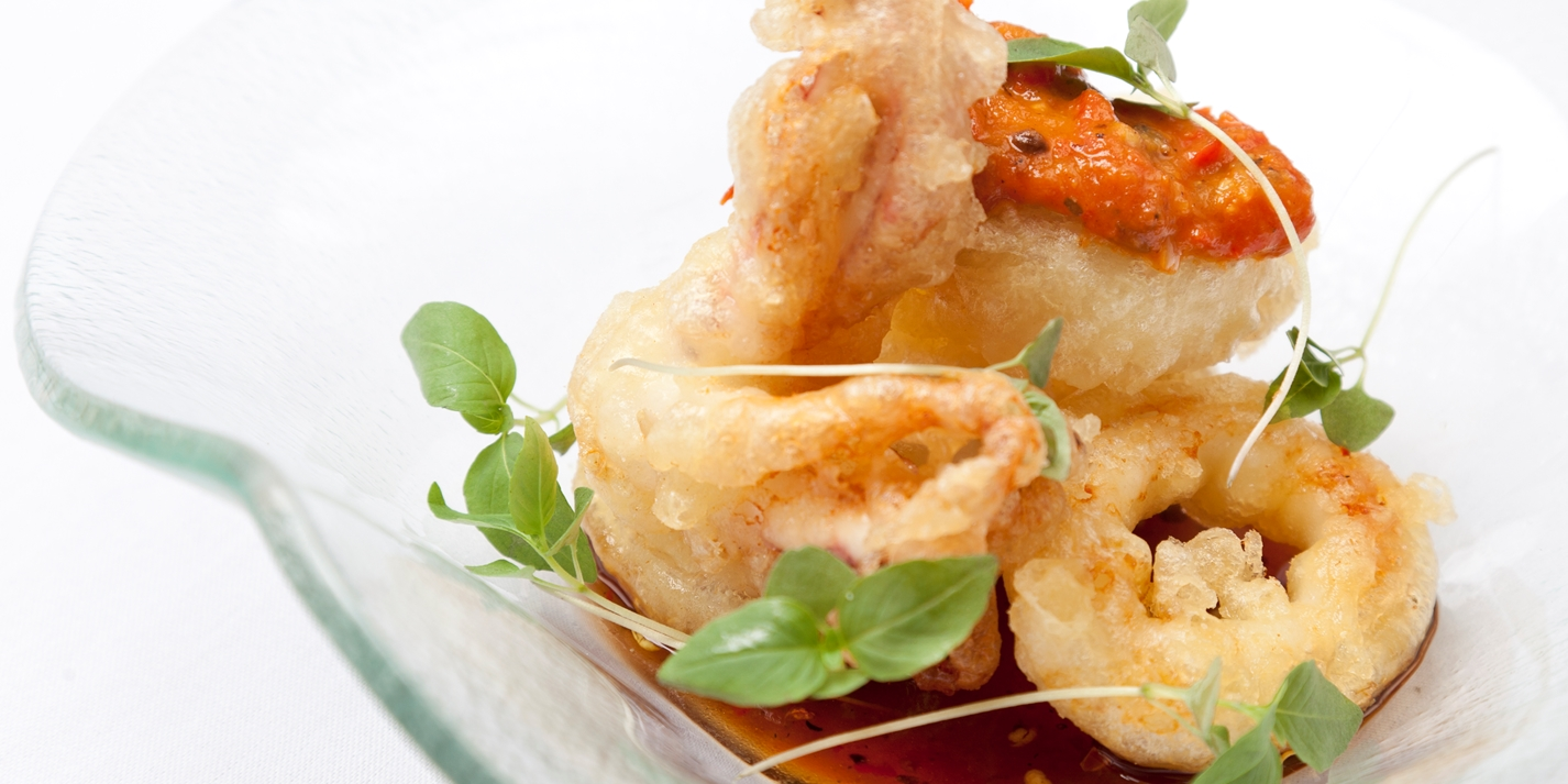 Fried squid with tomato and pepper compôte, tomato salsa and dipping sauce