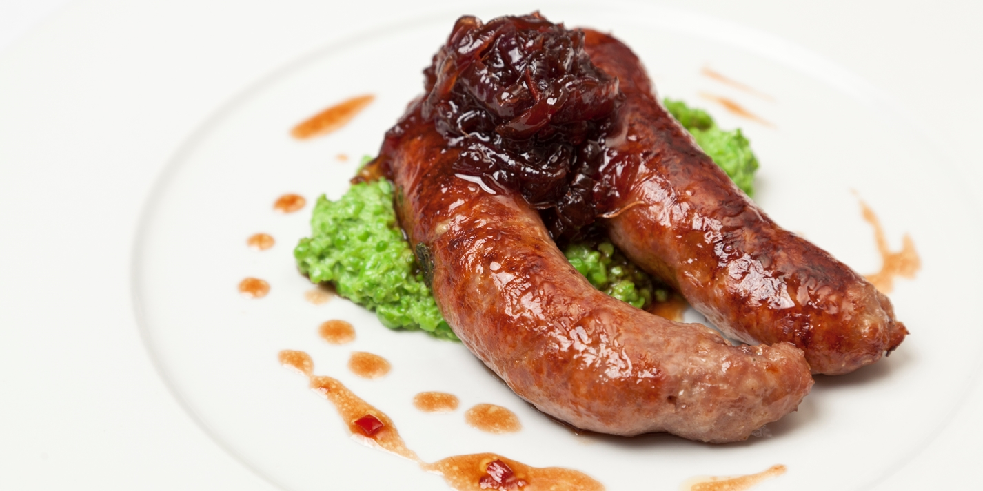 Grilled Norfolk sausages with crushed peas and onion marmalade
