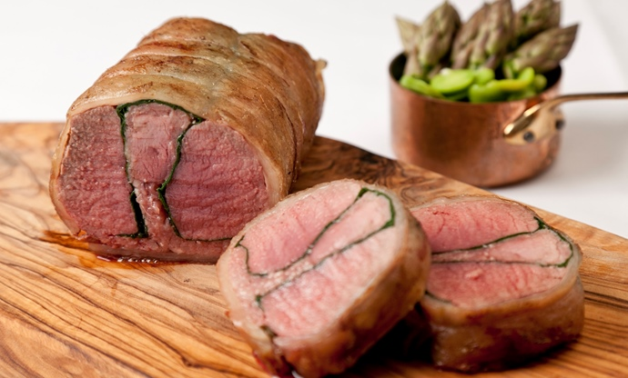 Roast whole saddle of lamb with spinach and black pudding