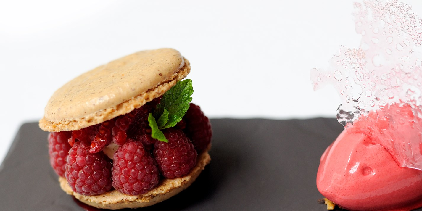 Hazelnut macarons with raspberry sorbet and rose opaline