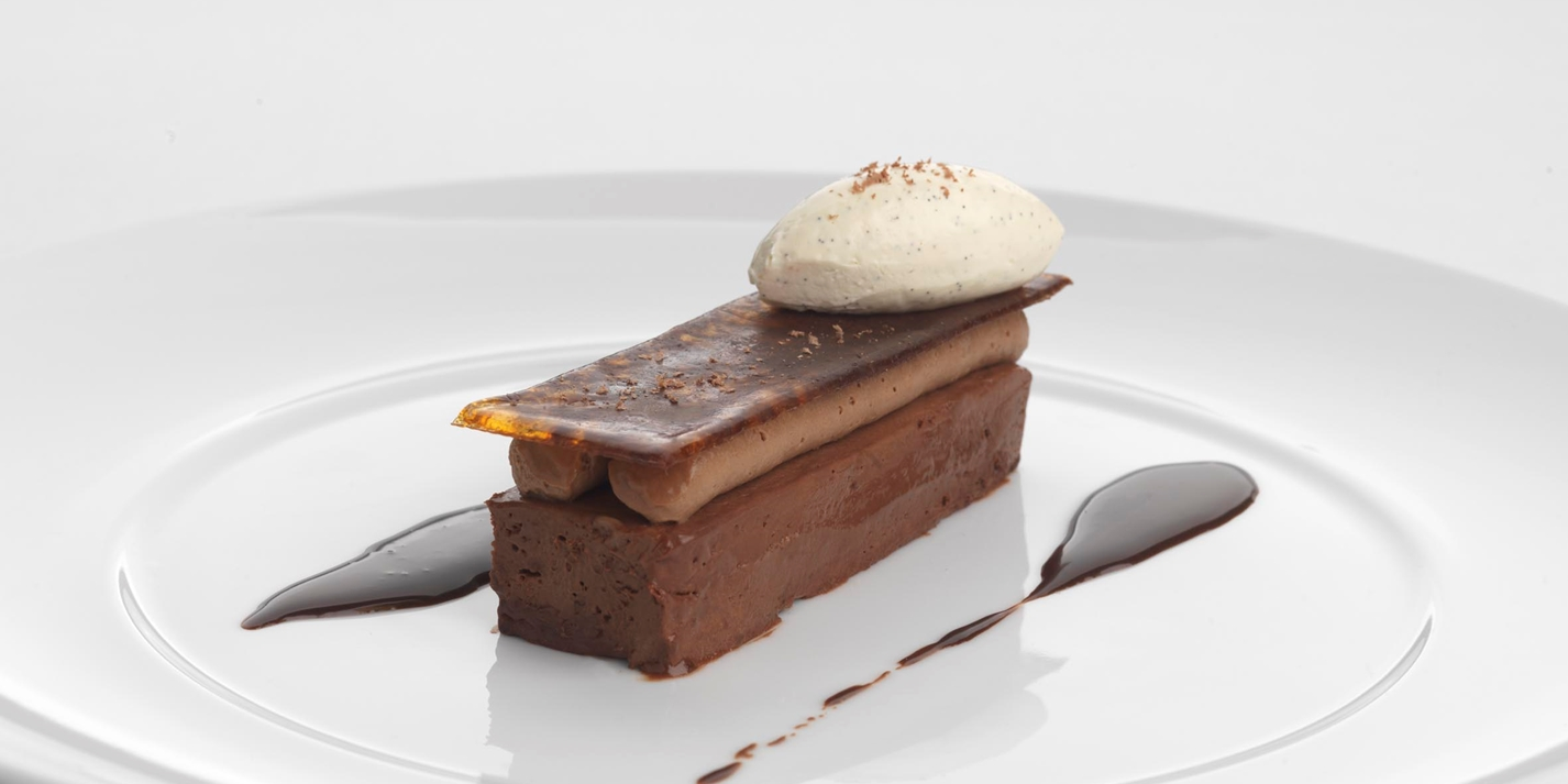 Salted chocolate delice with coffee mousse and rum crème fraîche