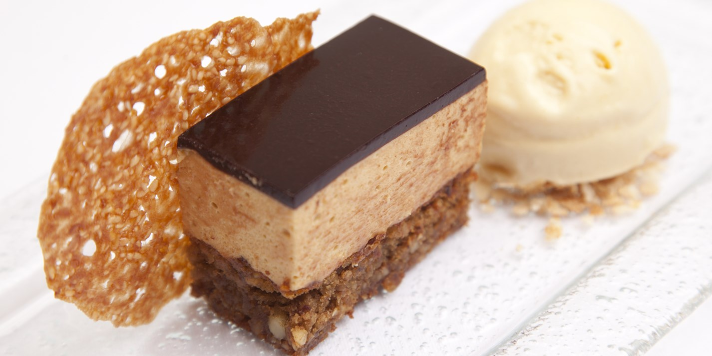 Hazelnut, caramel and sesame mousse cake with malt ice cream