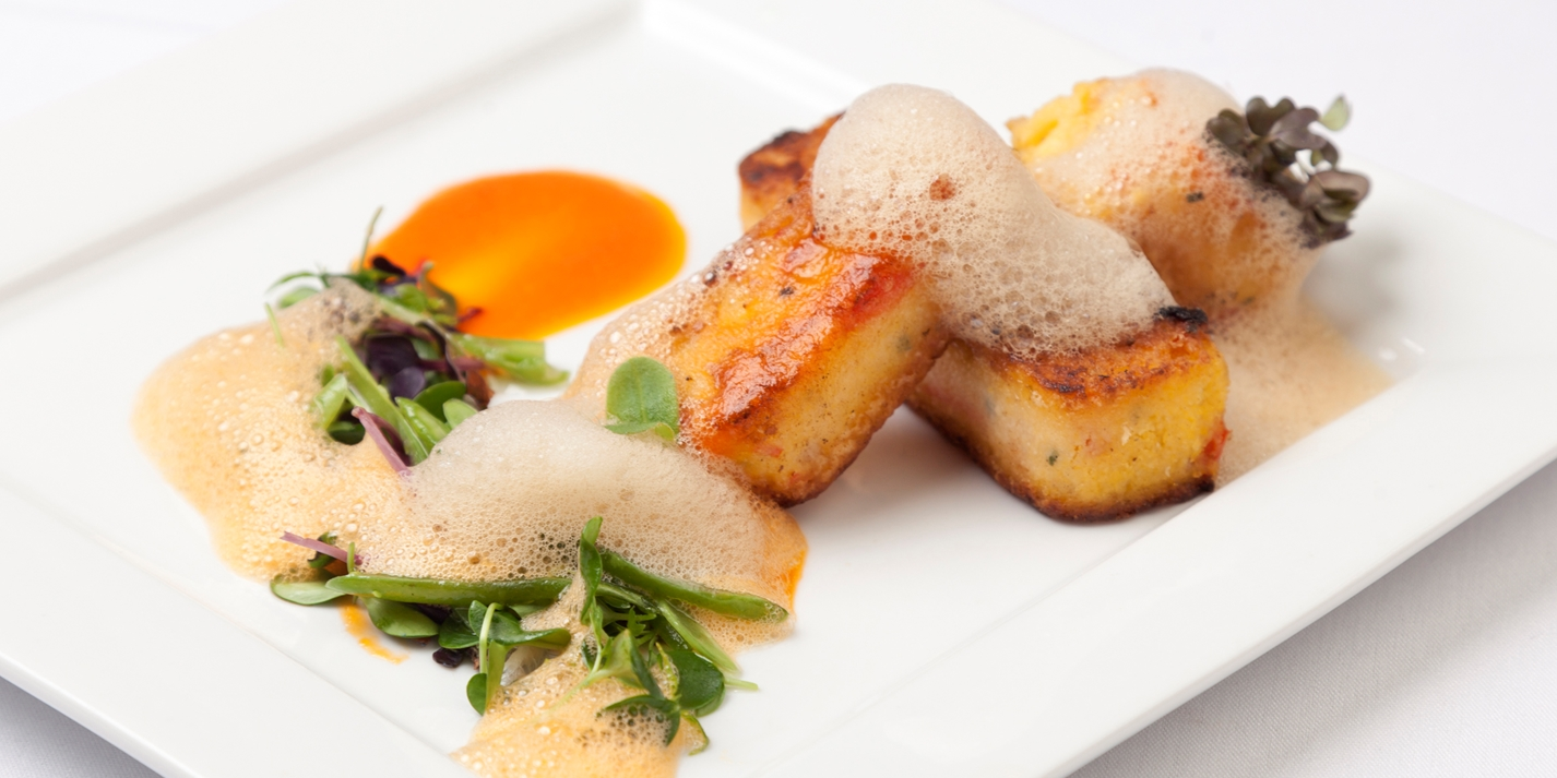 Roasted red pepper polenta with red pepper purée, green beans and soy foam