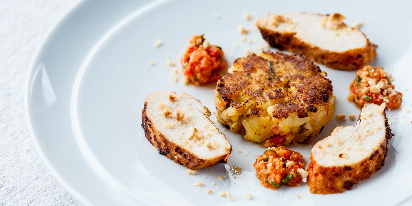 Chargrilled chilli chicken breast with Jersey Royals and romesco cakes