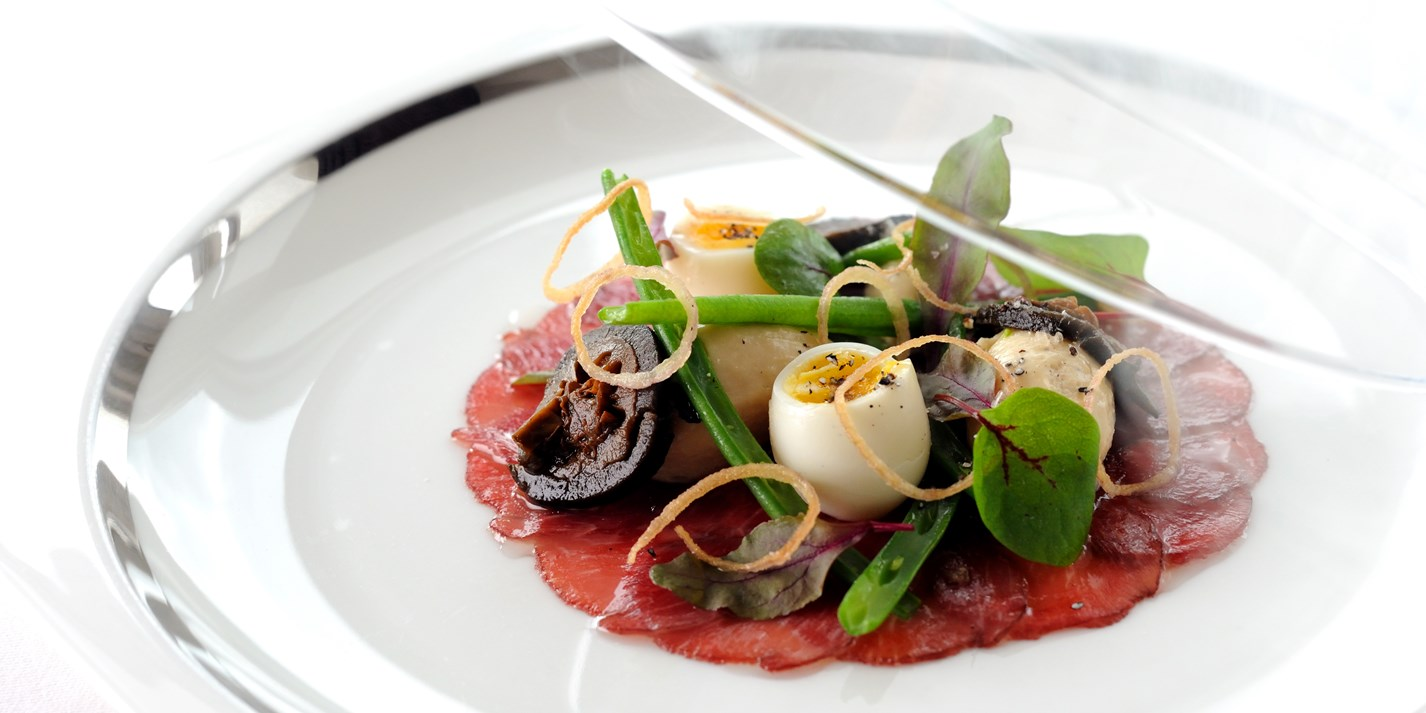 Lightly smoked plate of lamb carpaccio with shallot mousse, pickled walnut and quails eggs